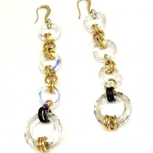 Four Swarovski crystal circles linked with gold and black earrings